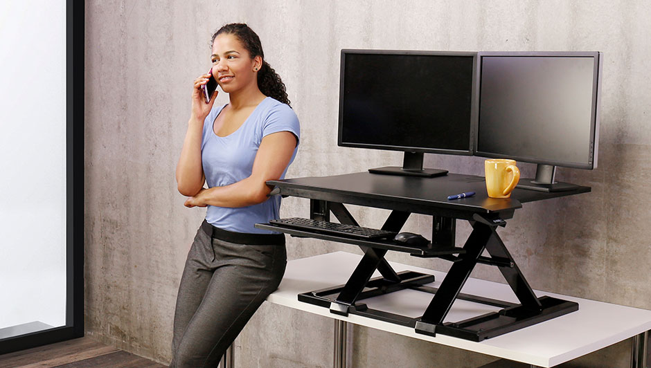 woman-leaning-against-standing-desks