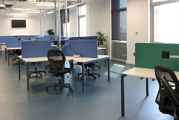 Colourful modular office desks in an open plan office